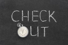 Check out. Phrase handwritten on chalkboard with vintage precise stopwatch used instead of O Royalty Free Stock Photos