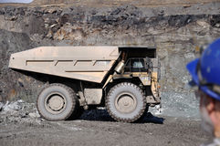 Check it out. WESTPORT, NEW ZEALAND, AUGUST 31, 2013: Miner surveys a Coal truck capable of carrying 70 ton, Stockton Coal Mine, Westland, New Zealand Stock Photography