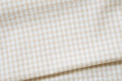 Beige check pattern fabric fold background