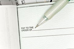Check and pen. Background with check and pen Stock Photos