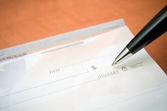 Check and pen, business concept Stock Images