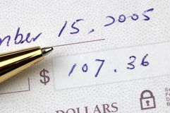 Check and pen in close up Stock Image