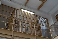 Check point in the prison. Checkpoint in the prison corridor surrounded by bars, cell, jail, penitentiary, justice, criminal, old, building, crime, interior royalty free stock photos
