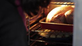 Check potatoes and the turkey in the oven stock video