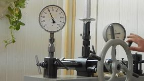 Check the pressure gauge on the press. stock video