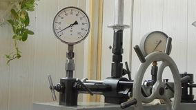 Check the pressure gauge on the press. stock video footage