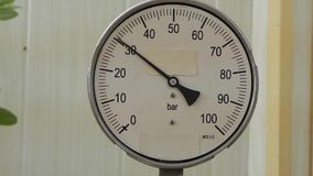 Check the pressure gauge. stock footage