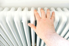 Check radiator temperature domestic heater with hand Royalty Free Stock Photography
