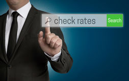 Check Rates internet browser is operated by businessman.  royalty free stock photos