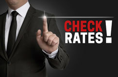 Check rates touchscreen is operated by businessman Royalty Free Stock Photography