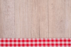Check in red and white as background. Check in red and white on wood as background royalty free stock photos