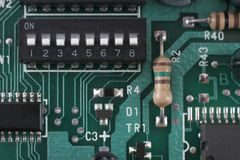 Check the Settings. Macro of DIP switch settings and circuit board Stock Photography