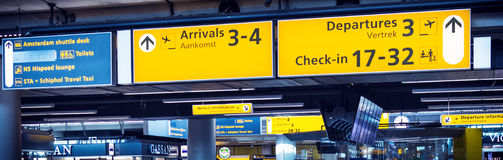Check-in sign at airport. HILVERSUM, NETHERLANDS - FEBRUARY 03, 2014: Amsterdam Airport Schiphol is the main international airport of the Netherlands. It is the Royalty Free Stock Photo