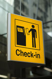 Check-in sign at airport. Yellow Check-in sign at the airport Royalty Free Stock Photo