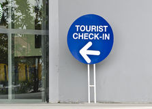 Check in sign. Tourist check in sign at department store Stock Photography