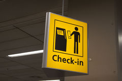Check in sign for travalers. Yellow check in sign on a airport Royalty Free Stock Photo