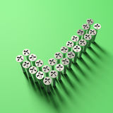 Check sing shaped with lot of screws on green background. Stock Photos