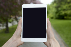 Check the tablet during walking on the street Royalty Free Stock Photo