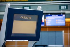Check-in terminal. An electronic self check-in terminal at an international airport Stock Photography