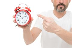 Check time. Man hold alarm clock in hand. Guy bearded mature man worry about time. What time is it. Time management and royalty free stock photography