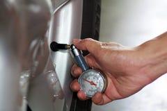 Check the tire pressure. Stock Image