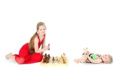 Check - two sisters play Royalty Free Stock Images