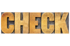 Check word typography in wood type Stock Photography