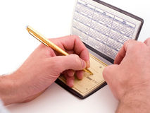 Check writer. Filling out a check stock photography