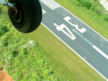 Check before you land. When a pilot lands at a seldom used airstrip, he must fly over before he lands Stock Photos