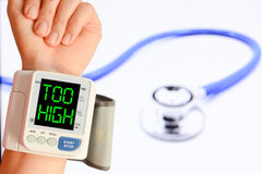Check your blood pressure and pulse to prevent heart problems Royalty Free Stock Image