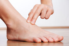 Check your pulse on your foot. At home Royalty Free Stock Images