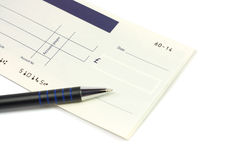 Checkbook. Opened checkbook and pen over white background Royalty Free Stock Photo