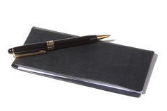 Checkbook. And pen with white background stock photos