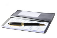 Checkbook. And pen with white background stock photography