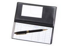 Checkbook. And pen with white background royalty free stock images