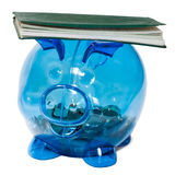 Checkbook balanced on a piggy bank. A piggy bank with coins in it balancing a checkbook, all isolated on a white background stock photos