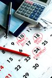 A checkbook, bills, a calculator and a calendar Royalty Free Stock Photography