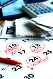 A checkbook, bills, a calculator and a calendar Royalty Free Stock Photo