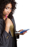 Checkbook Businesswoman. African american businesswoman holding checkbook royalty free stock photos