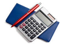 Checkbook,calculator and pen. A pen and calculator sitting on checkbook isolated on white royalty free stock image