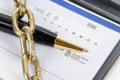 Checkbook and Chain Royalty Free Stock Photography