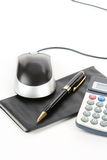 Checkbook and computer mouse Stock Photography