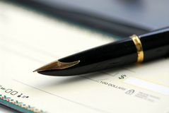 Checkbook pen Stock Images