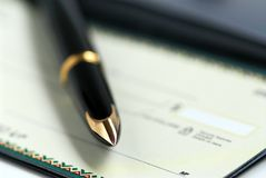Checkbook pen Royalty Free Stock Images