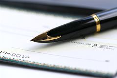 Checkbook pen Royalty-vrije Stock Foto's