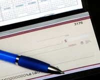 Checkbook and pen. Detailed image of a blank checkbook with pen stock image