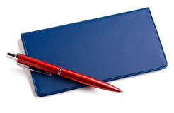 Checkbook and pen. A pen sitting on checkbook isolated on white royalty free stock images