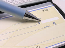 Checkbook with pen 2. Check in checkbook with pen pointing at dollar amount royalty free stock images