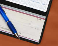 Checkbook and pen on leather background Royalty Free Stock Photos