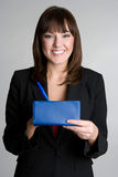 Checkbook Woman. Beautiful business woman holding checkbook stock photo